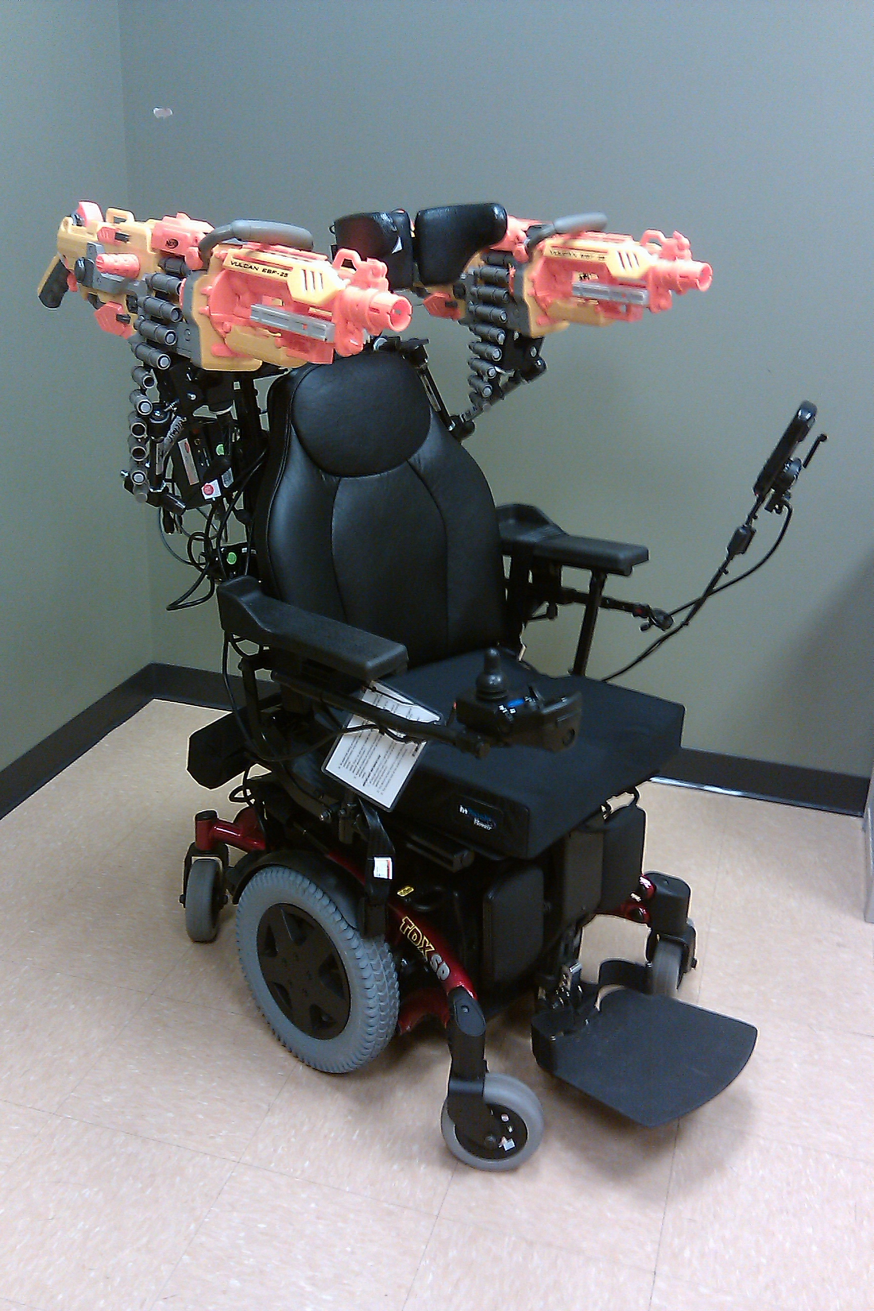 Wheelchair with Nerf machineguns mounted